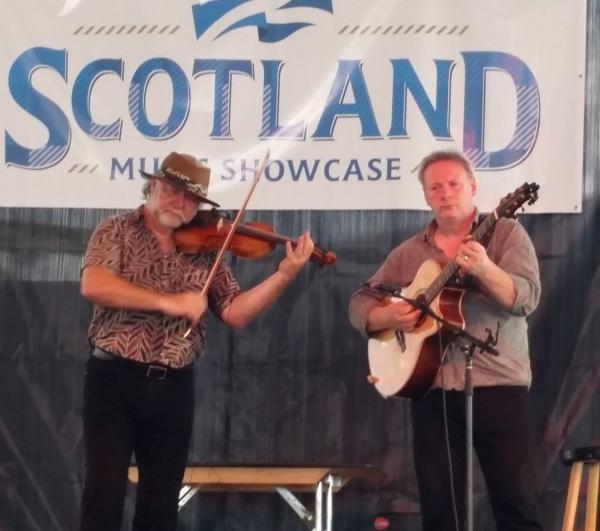 Scottish fiddler Alasdair Fraser and Scottish fingerstyle guitarist Tony McManus perform at Irish Fest.