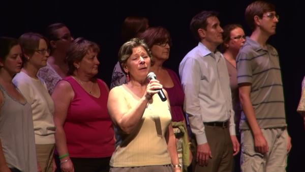 Mezzo Soprano Leslie Fitzwater, rehearsing with the One Voice Community Choir