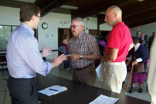 Residents speak with County Executive Chris Abele following Thursday's budget hearing