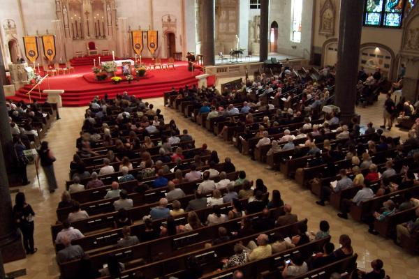 Hundreds remember James Foley at a memorial vigil at Gesu Church Tuesday evening