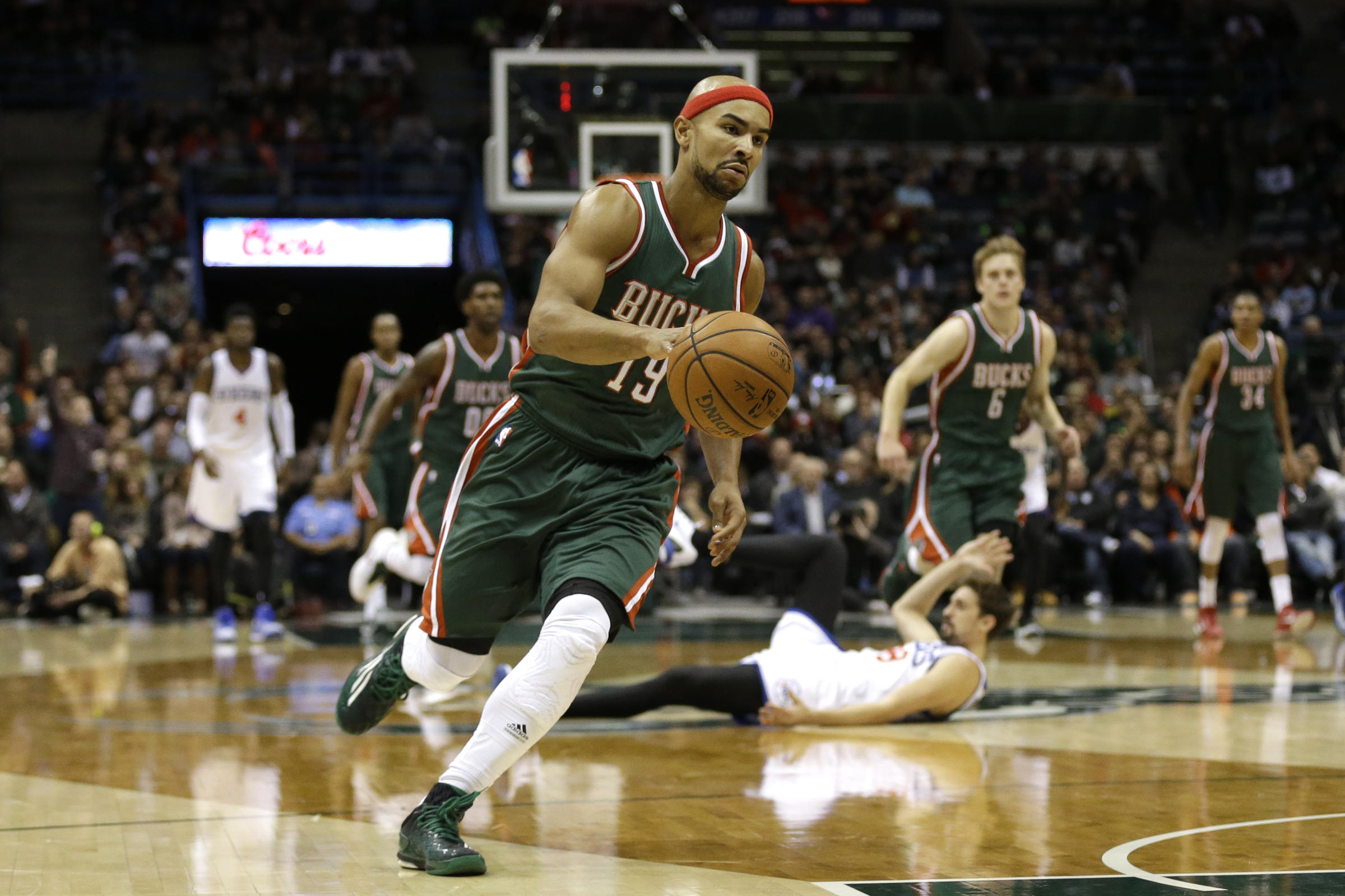 d58f3557e1a Jerryd Bayless  19 of the Milwaukee Bucks drives to the hoop on a fast  break for two points during the second half against the Philadelphia 76ers  against ...