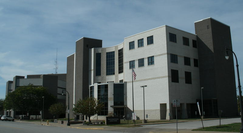 The Rock Island County Criminal Justice Center is in the foreground with the county jail to the west (left).