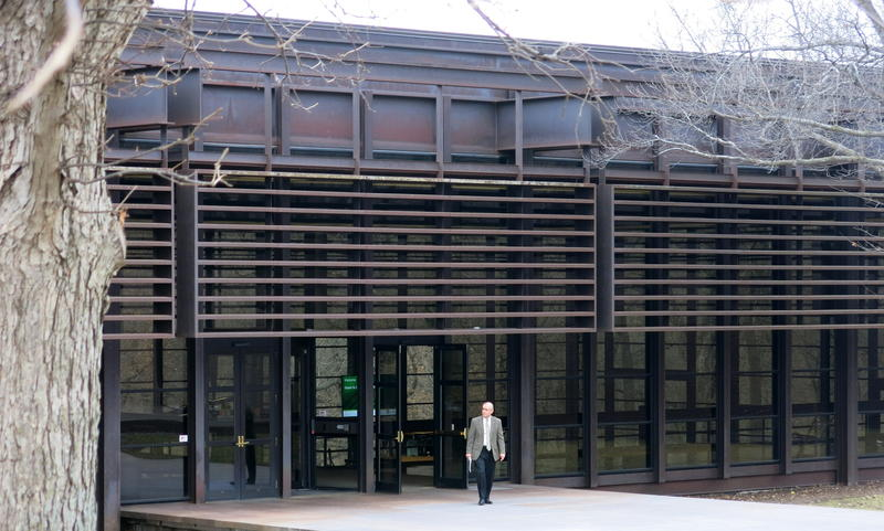 A man leaves the John Deere World Headquarters after the annual meeting.