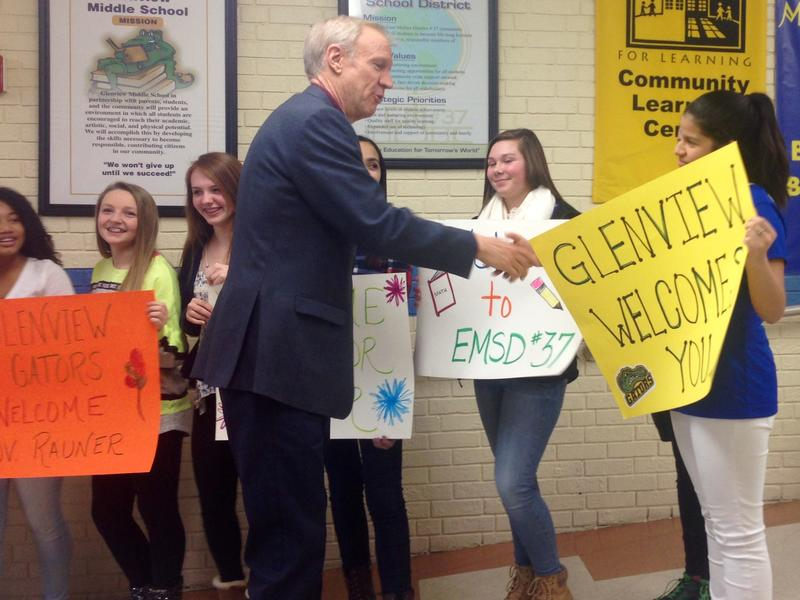 Governor Bruce Rauner greets students as he arrives at Glenview Middle School in East Moline. He visited the school to talk about the importance of education and reforming the funding formula.