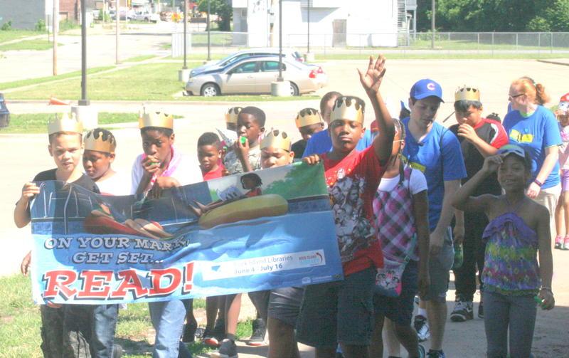 Students at Spring Forward Summer Camp Kick-off parade at Rock Island Academy