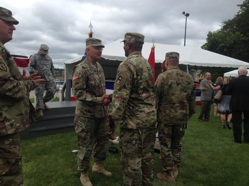 Soldiers and guests shake hands with outgoing First Army Commanding General  Lieutenant General Michael Tucker.