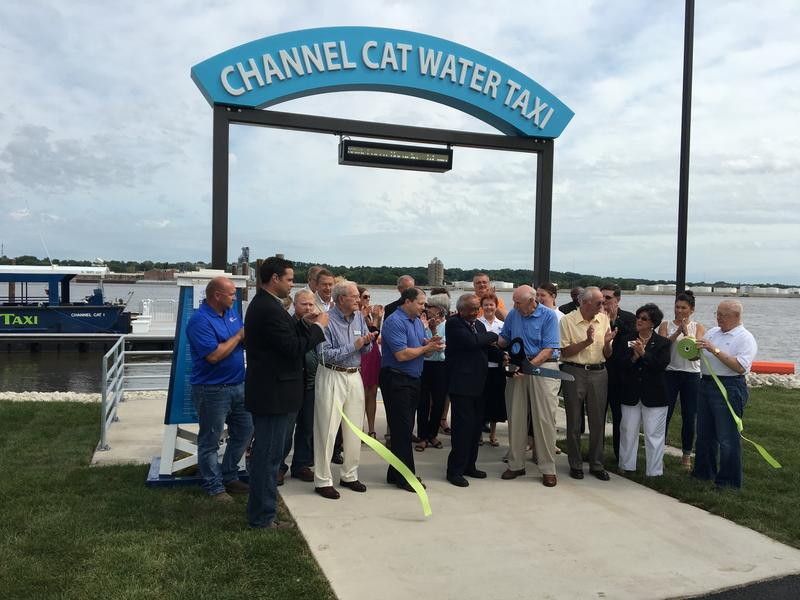 Metro Link officials & others cut a ribbon at the Channel Cat's new dock in Moline.