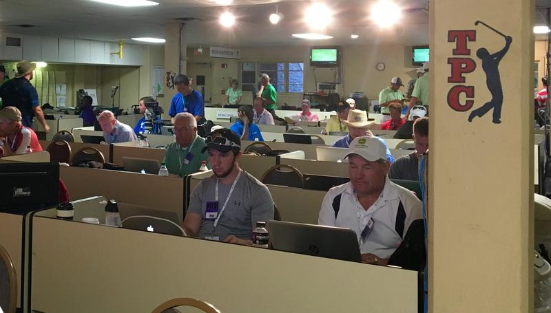 Rows of reporters, producers and photographers covering the John Deere Classic work in the media room at TPC Deere Run.
