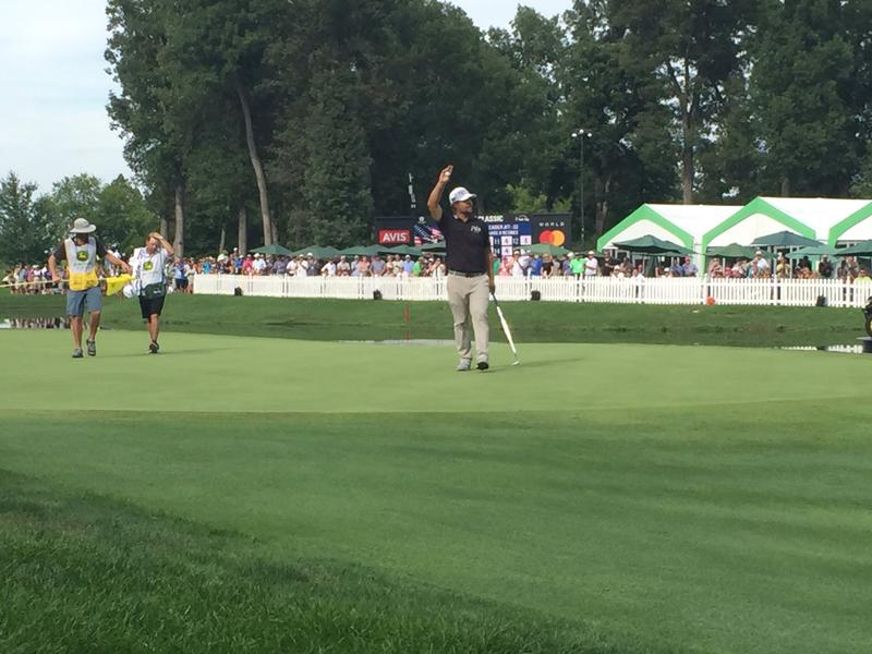 2016 John Deere Classic Champion Ryan Moore waves to the crowd after his final putt on the 18th green.