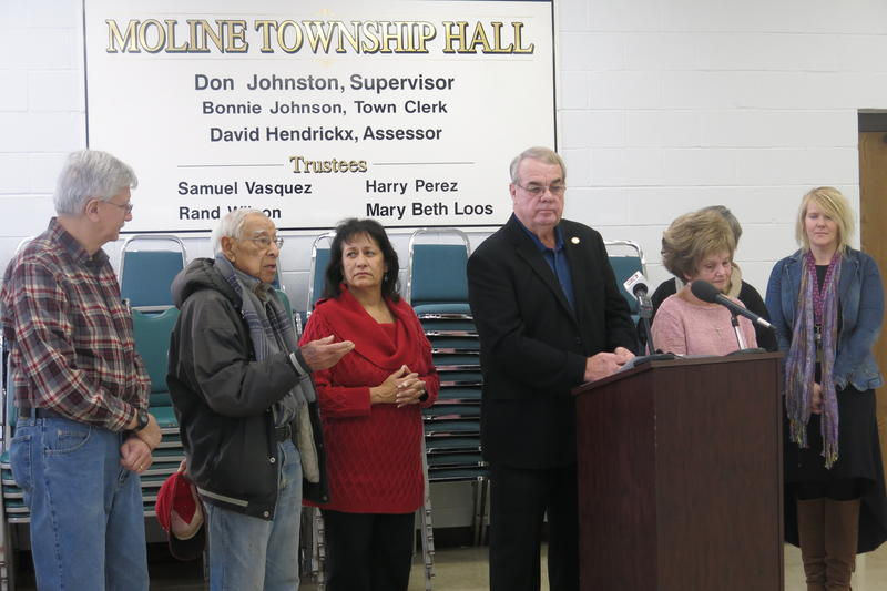 Township officials discuss emergency housing funding at Moline Township Hall.