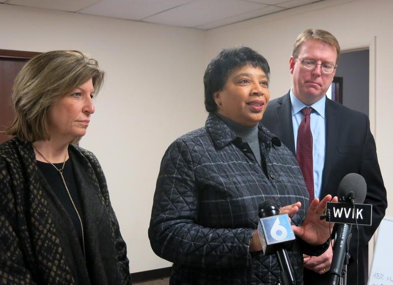 Davenport St. Rep. Phyllis Thede (center) talks while Wheatland St. Sen. Rita Hart (left) & Cedar Rapids St. Sen. Rob Hogg (right) listen at Scott Co. Democratic headquarters in Davenport.