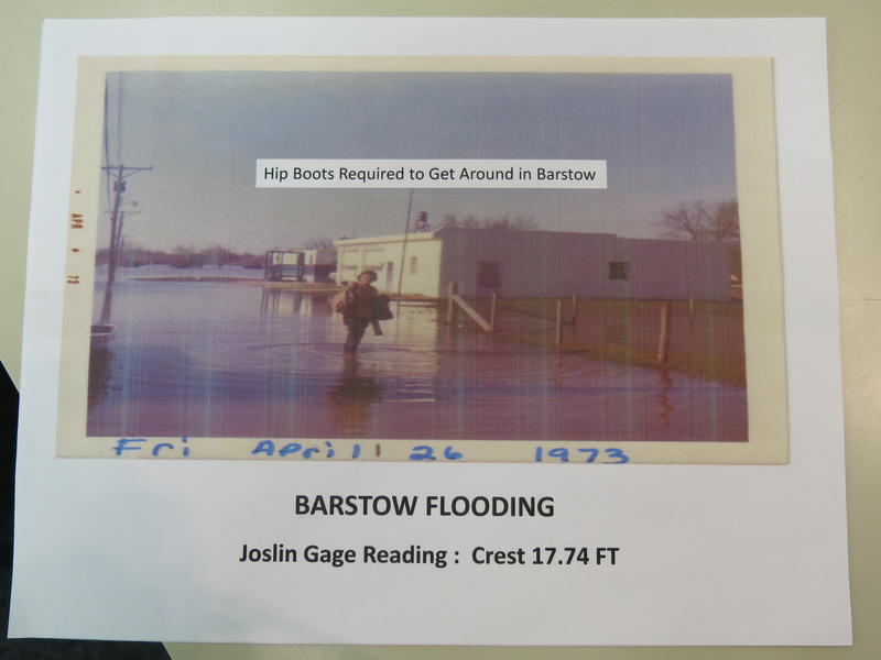 Photo of a woman in front of the Barstow Fire Station during a flood in the 1970s