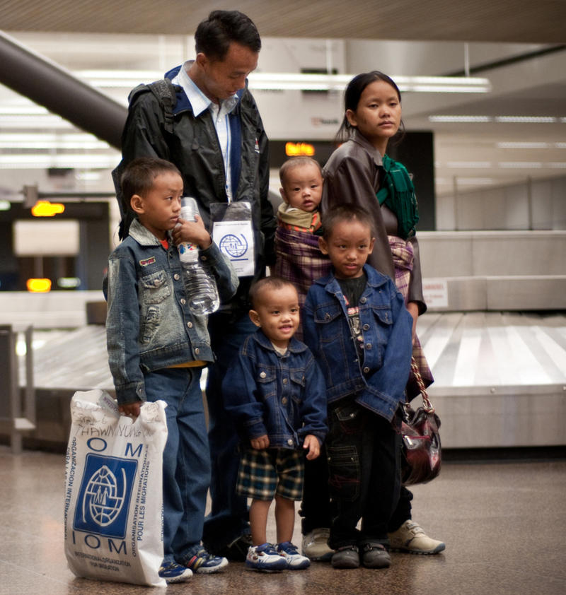 A refugee family arrives at the Quad City International Airport (luggage claim).