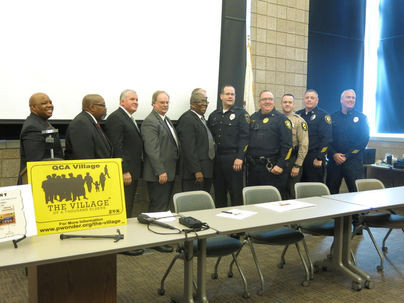 Pastors, police chiefs, troopers, and sheriffs pose for photos after signing the covenant.