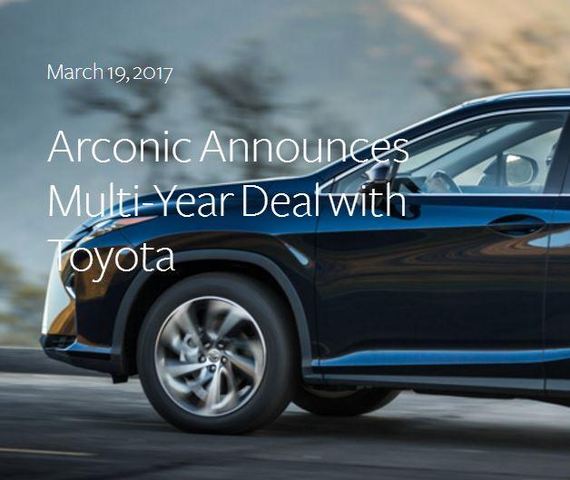 "You see half of a dark blue car with the words, ""March 19, 2017 Arconic Announces Multi-Year Deal with Toyota"