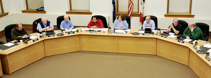 The Muscatine City Council and Mayor at work.