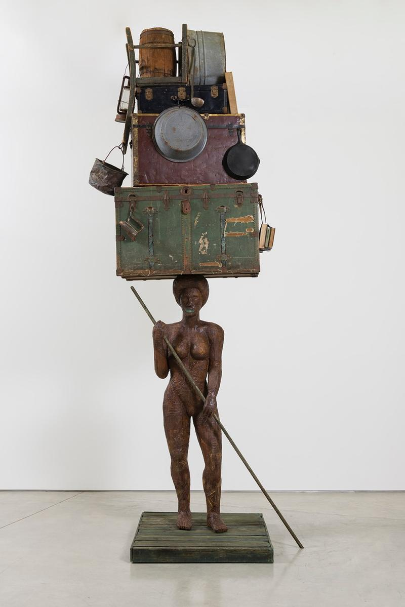 Alison Saar (American), Breach (large figure on raft), 2016, Wood, ceiling tin, found trunks, washtubs and miscellaneous objects. Copyright Alison Saar.