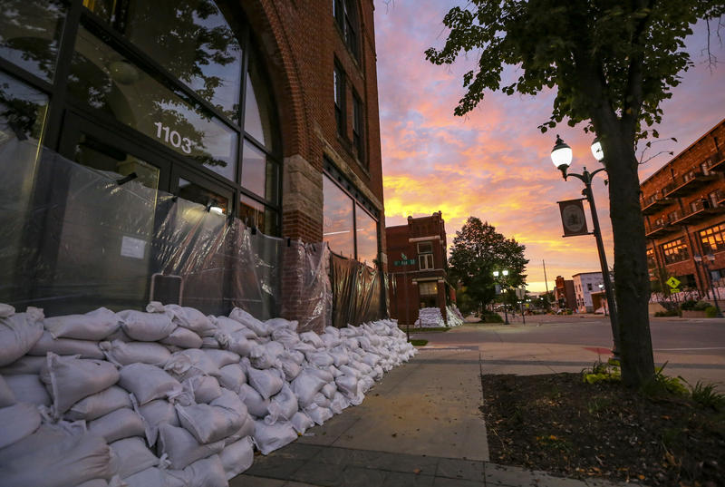 The front of the CSPS building, protected by sand bags and plastic sheeting, as the sun sets in Cedar Rapids on Sunday, September 25, 2016.