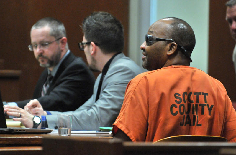 Stanley Liggins sits at the defense table with attorneys Derek Jones (left) and Miguel Puentes during a pretrial hearing.