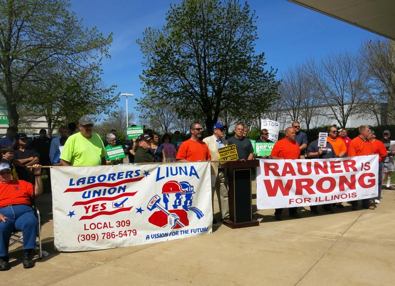 Protestors gather in Moline Monday, April 17 to advocate for union rights, fair contracts and education funding.