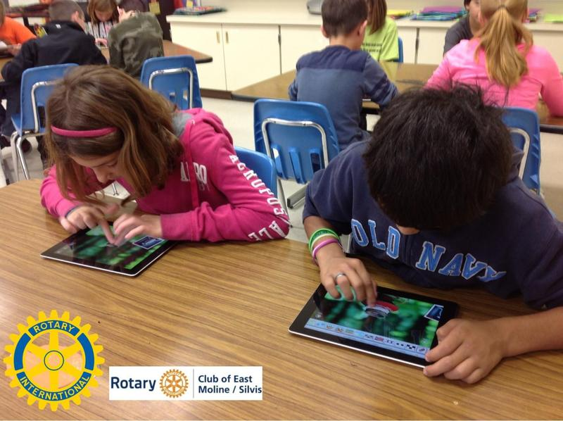 Kids try out new iPads that will be donated to six schools in East Moline and Silvis.