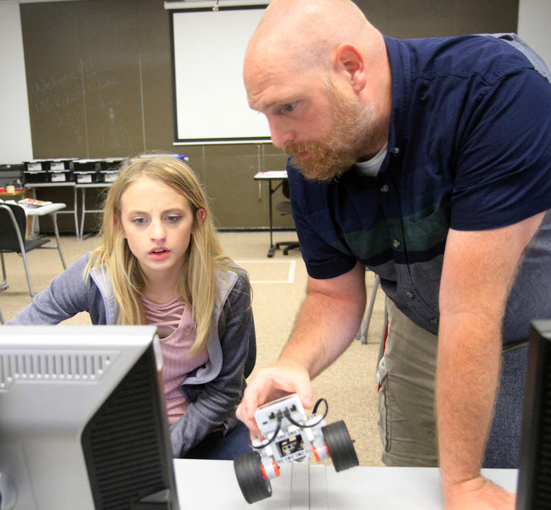 Abingdon-Avon High School student Morgan Patrick works on program coding with the help of Antony Bentley, Dir. TRIO Upward Bound at CSC during robotics class.