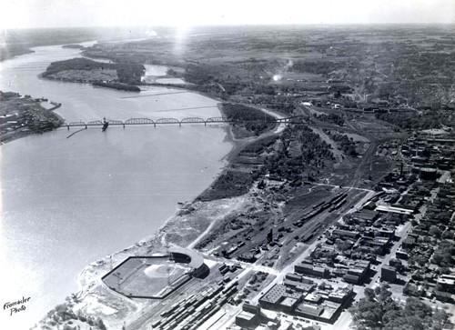 Historic aerial photo of the Davenport riverfront with John O'Donnell Stadium in the foreground, Crescent Railroad Bridge & Credit Island in the background.