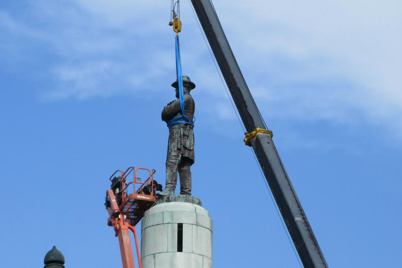 Crews remove a statue of Confederate General Robert E Lee from Lee Circle in New Orleans.