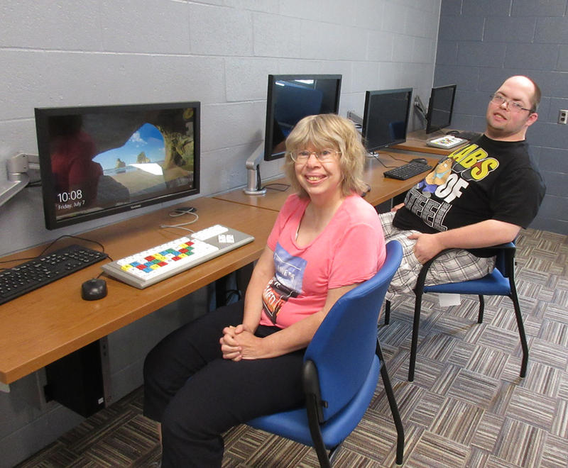 Clients sit at new computer work stations at the Handicapped Development Center in Davenport, Iowa.