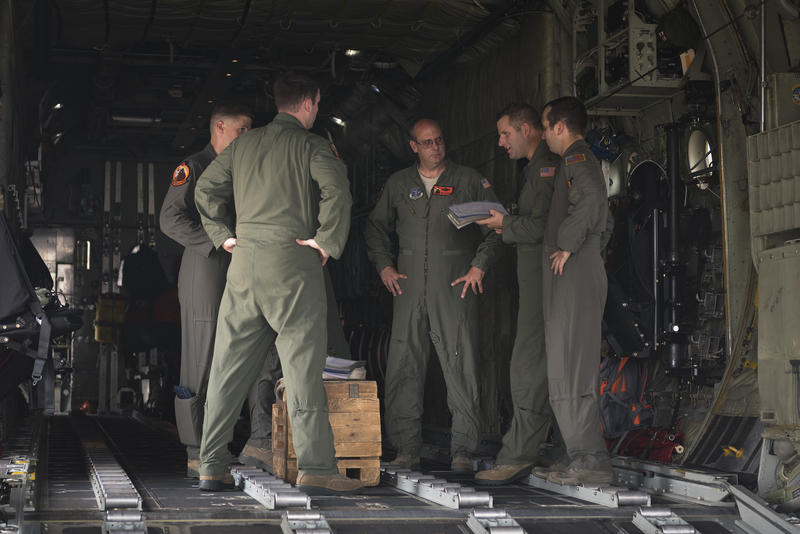 U.S. Air Force Maj. Matthew Cain, (2nd from L), a C-130 Hercules aircraft commander with the 169th Airlift Squadron, Illinois Air National Guard, conducts a mission brief before departing Peoria, IL, Aug. 31, 2017.