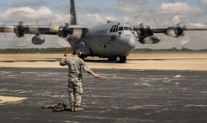 U.S. Air Force Master Sgt. Clint Carter, maintenance craftsman with the 182nd Aircraft Maintenance Squadron, Illinois Air National Guard, marshals a C-130H Hercules, Aug. 31, 2017, Peoria, IL.