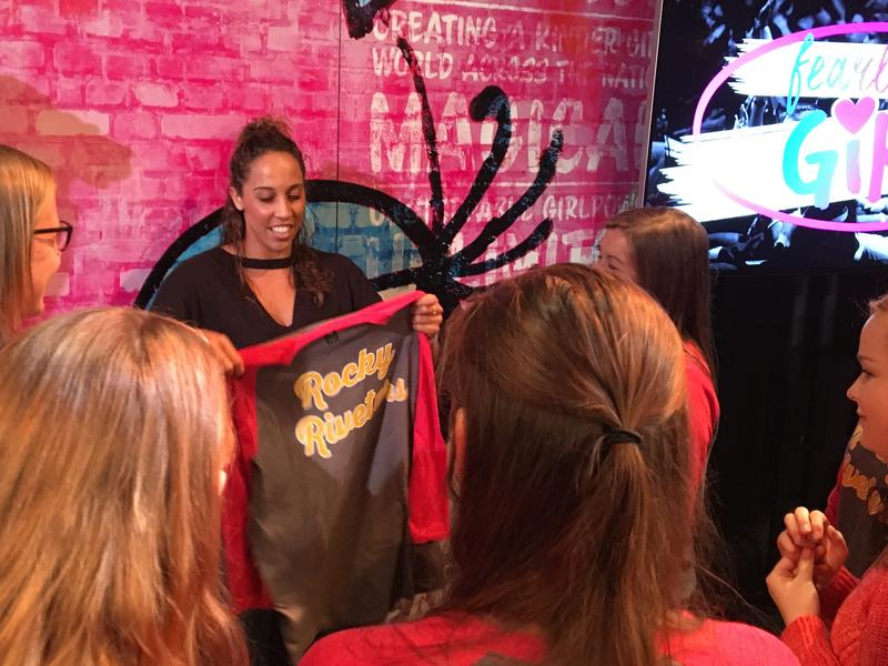 Madison Keys meets students from Rock Island High School's new women's empowerment group, the Rocky Riveters.
