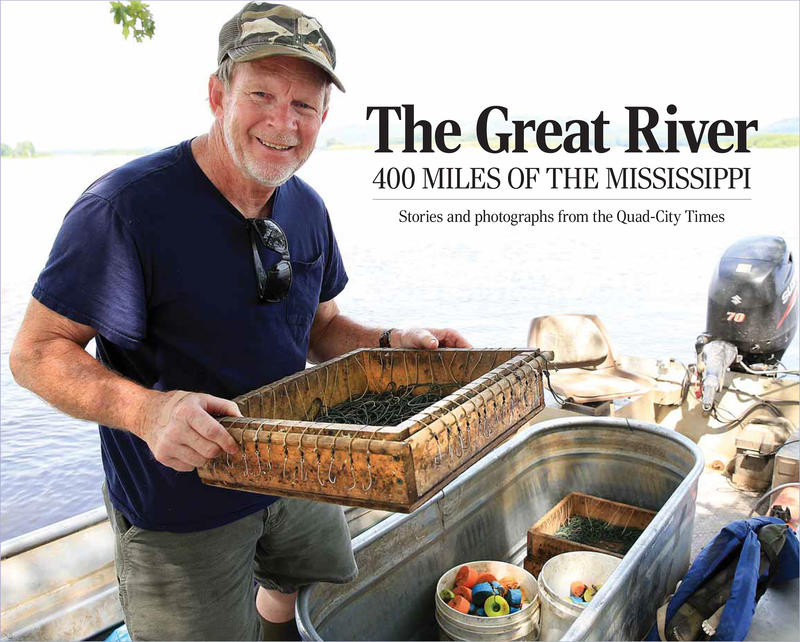 Commercial fisherman Dennis Weiss of Bellevue, Iowa, loads a box containing one of his 50-hook trotlines into his boat before heading out one afternoon this past July on the Mississippi River.