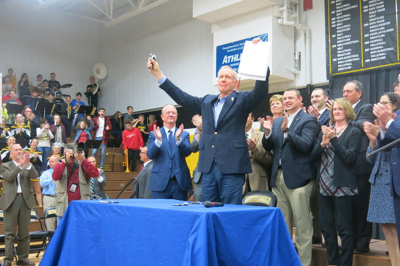 Illinois Governor Bruce Rauner after signing the bill last year, at Riverdale High School in Port Byron