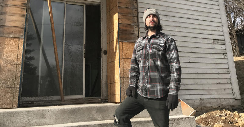 Musician Mikey Loy stands in front of an old church he bought in LeClaire, Iowa. In February, Loy was renovating the building into a recording studio when he fell 16 feet onto the hardwood floor.