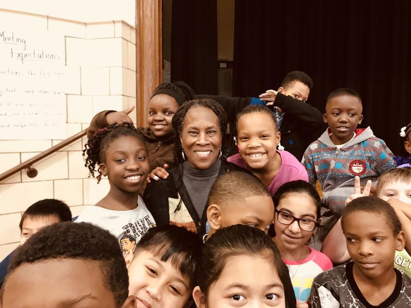 Charlotte Blake Alston with students at Frances Willard Elementary School in Rock Island