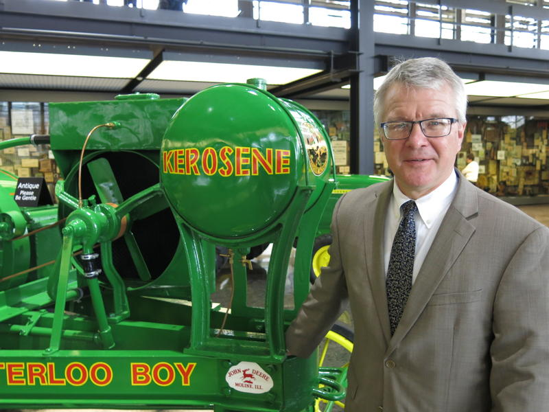 """Self-described """"rabid John Deere tractor collector,"""" Tony Knobbe who's standing by a restored Waterloo Boy. He is one of the organizers of the Gathering of the Green."""