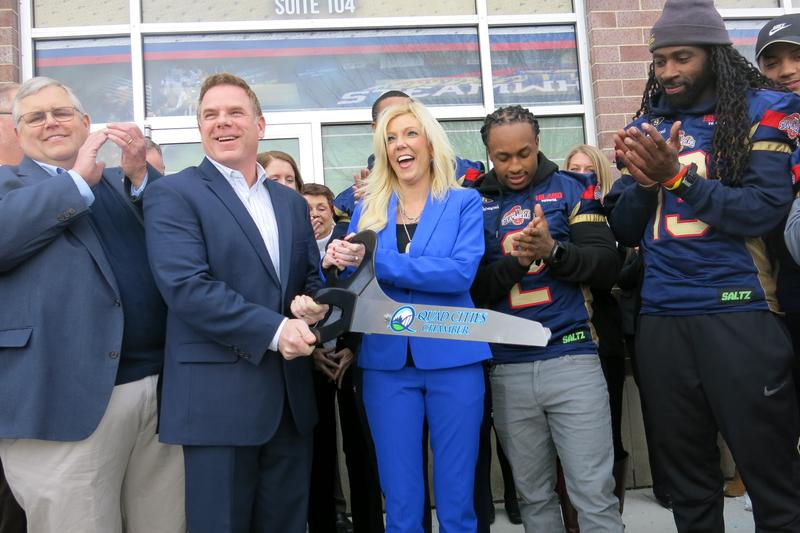 Steamwheelers co-owners Doug & Crystal Bland, with Moline Mayor Pro Tem David Park (l), and players Tyler Williams & Keyvan Rudd (r)