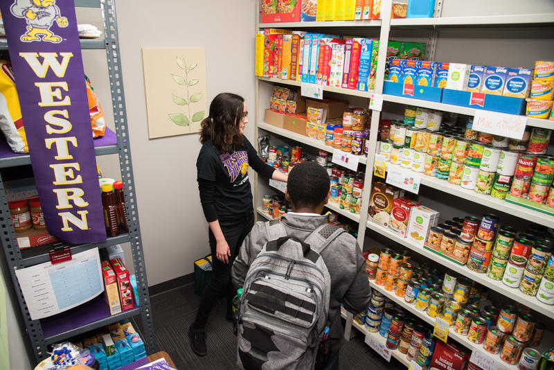 at the WIU-QC food pantry, manager Haley Dutmer talks with a student