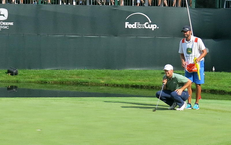 Jordan Spieth & his caddy, Michael Greller, line up a putt during the 2015 John Deere Classic, Silvis, IL.