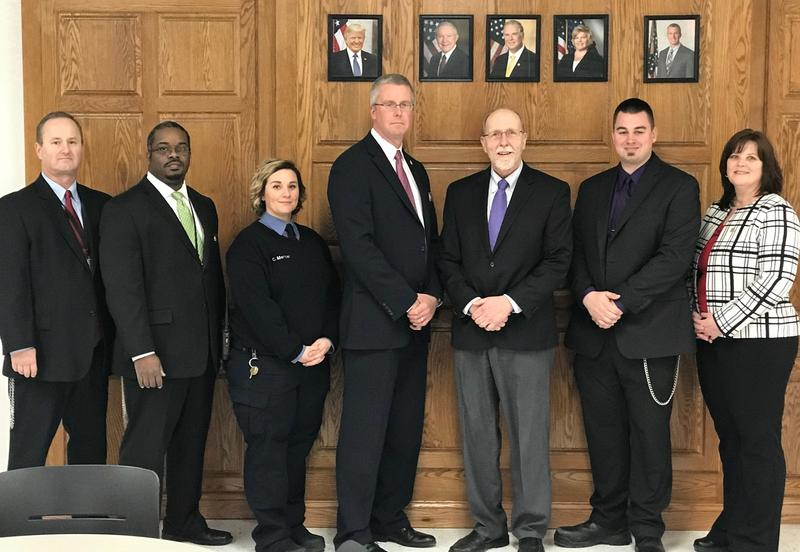 Iowa US Congressman Dave Loebsack (3rd from right) poses for a photo with Thomson prison employees.