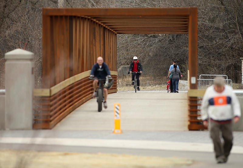 Cyclists cross the new bike and pedestrian bridge that links Sylvan Island with the north shore of Moline. The bridge opened December 2017, several years after the City of Moline closed the previous bridge after it was deemed unsafe.
