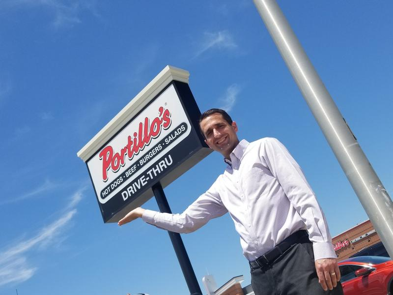 Davenport Chief Financial Officer and Assistant City Administrator Brandon Wright stands in front of a Portillo's restaurant
