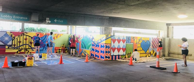 Mural in progress at the south parking ramp of Genesis East Medical Center in Davenport