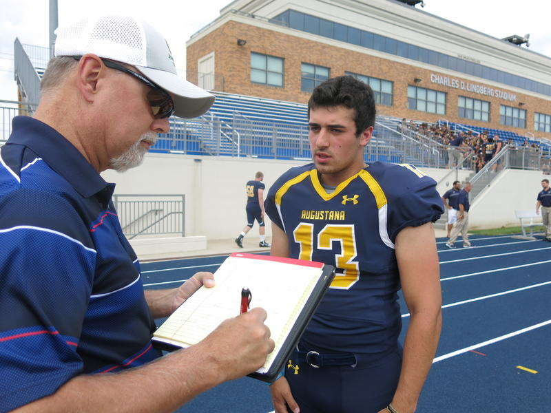 Sports Writer, Tom Johnston, from the Rock Island Argus & Moline Dispatch, interviews Alek Jacobs, a sophomore quarterback from Rock Island.