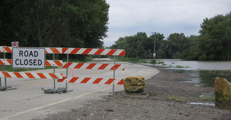 The road to Credit Island in Davenport, Iowa is closed due to flooding.