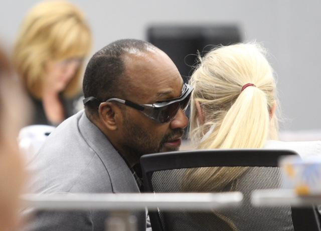 Stanley Carter Liggins talks with defense attorney Nichole Watt during trial on Sept. 4, 2018.