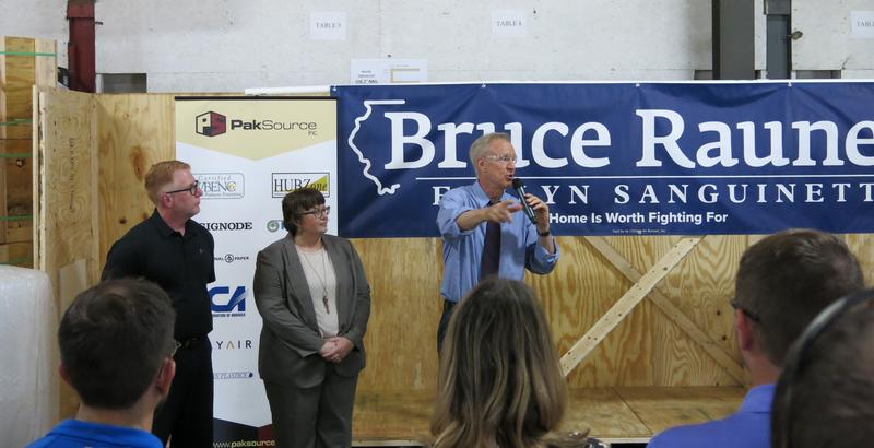 Ill. Gov. Bruce Rauner campaigning at Pak Source in Rock Island, with owners Rob & Brenda Gillman looking on.