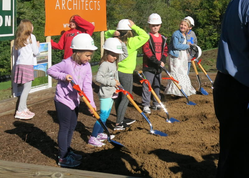 Students at Bettendorf's Mark Twain Elementary School break ground on a new building.