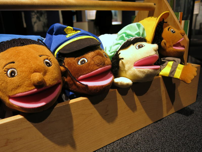 Children can play with puppets and read books about race.